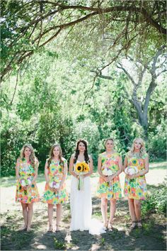 colorful floral bridesmaid dresses http://www.weddingchicks.com/2013/10/24/colorful-eclectic-wedding/