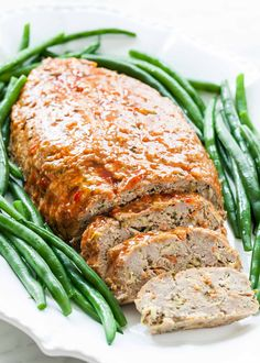 Turkey Meatloaf! Made with ground turkey, grated zucchini and carrot, parsley, and seasonings. Sweet chili sauce brushed on top. #Turkey #Meatloaf #Dinner #EasyDinner
