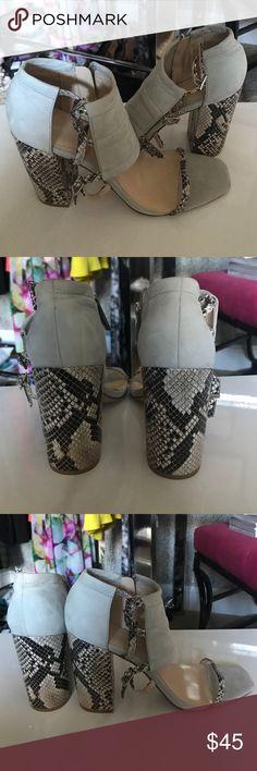 Calvin Klein Linda Sandals Calvin Klein Linda Sandals. Python and Neutral. New. Never been worn. Suede upper Calvin Klein Shoes Heels