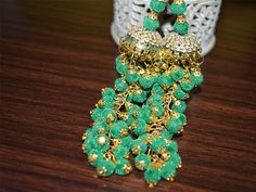 1 pair of Decorative Green Golden Hanging Beaded Tassel for Wedding Lehenga Dress, Blouses. This is embellished with rhinestone beads. This stunning Tassel can be used for: ➤ wedding dress...