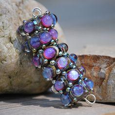 Handmade lampwork beads with kalypso dots