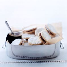 In some Latin American countries, these cookies, called alfajores, are made with Pisco — brandy distilled from white Muscat grapes grown in Peru, Chile, and Bolivia — but regular brandy works fine.