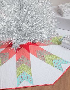 """Don't let all the points in this tree skirt fool you--use quick-and-easy strip piecing to stitch it up quick! """"Skirted"""" tree skirt from the book Simply Modern Christmas by Cindy Lammon."""