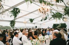 Nadia Coppolino's wedding marquee featured bunches of green foliage, hydrangeas, roses, lisianthus and phalaenopsis suspended from the roof.