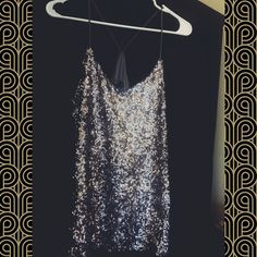 ⬇️⬇️PRICE DROP⬇️⬇️ {Sparkly} Sequin Tank Top Never been worn! Sparkly, silver sequin tank top with super cute back and thin straps. Express Tops Tank Tops
