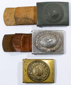 Lot 334: World War I and World War II German Belt Buckles; Three items including two buckles with leather tabs