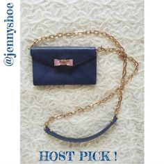 host pick! {tory burch} bow envelope crossbody Authentic and cute Tory Burch Bow Envelope mini crossbody in blue with a pink bow and gold hardware. Had a detachable strap with a gold chain so you can carry it as a clutch on a night out!   Snap closure and 3 card slots  Measures approx 4 x 6.5 x 1.5 with a 22 inch strap drop  Has some small stains as pictured in photo 4. Otherwise, gently worn.  No trades please. Tory Burch Bags Crossbody Bags