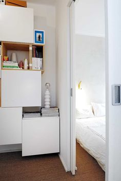 A clever use of space: sliding door and box storage.