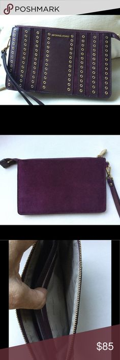 """Michael Kors plum leather & suede clutch (NWOT) Plum beautiful Michael Kors clutch or large wristlet.Measures a little over 8"""" wide and almost 5 and a half inches tall. Embellished with gold metal grommets and striped purple leather over suede. New with out tags perfect Michael Kors Bags Clutches & Wristlets"""