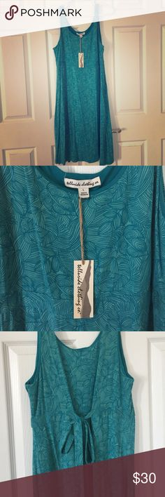 Telluride Clothing Co Teal Dress This beautiful teal tank dress features a tribal-like leaf pattern and a tie back. It is BNWT and has never been worn. Good length for someone taller. Super soft fabric! Telluride Clothing Co Dresses