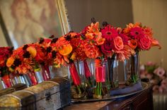 Beautiful red, orange and coral bouquets for fall weddings.  Flowers: Visual Impact Design  Photo: Sharpe Weddings  Venue: Newcastle Wedding Gardens