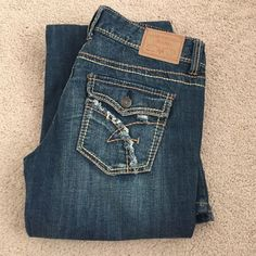 """Flare jeans Medium wash distressed ripped jeans. Low waist stretch jeans. Worn once.  33"""" inseam Jeans Flare & Wide Leg"""