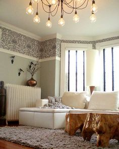 Interesting use of wallpaper..minimal amount but big impact! Love the colors in this room..truly relaxing!