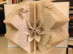 This is a simple, repetitive fold embellished with a single origami flower and butterflies.