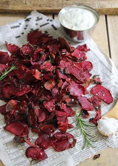 These rosemary sea salt and vinegar beet chips are a fun, crispy and healthier snack served with roasted garlic yogurt dip.