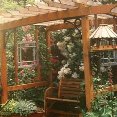 Pergola with windowpanes and bench. From Outdoor Living idea book. Pg 75.