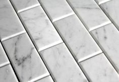 Look We Love: Beveled Subway Tile. Beveled Carrara marble tile — lovely and luxurious. From The Builder Depot.