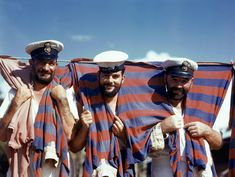 Three British sailors drape themselves with their soccer jerseys in Trinidad, June 1942.  Photograph by Luis Marden, National Geographic