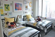 love love love this shared room. the artwork on the walls and the grey/white/yellow color combo = perfection
