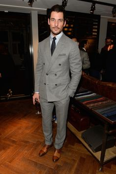 Dressing-up his button-down at the launch of the first Thom Sweeney ready-to-wear shop in London's Mayfair. Three guesses which label his impeccably cut grey DB is by... Vote for David Gandy to win GQ Readers' Best-Dressed Man 2015.