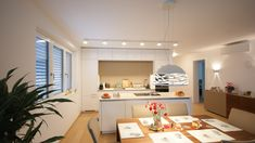 Viel Platz hat man in dieser Ewe Küche - zum Kochen, Essen und Wohnen. Die offene Wohnküche in Weiß lässt viel bunte Dekomöglichkeiten zu. Mehr konkrete Projekte auf: Küchen Design, Corner Desk, Furniture, Home Decor, Homes, Essen, Projects, Corner Table, Decoration Home