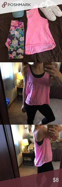 HOT PINK VS TANK Hot pink Victoria's Secret high low tank top. Perfect for the gym or paired with destroyed denim shorts and white Nikes. Staple in anyone's summer closet! Victoria's Secret Tops Tank Tops