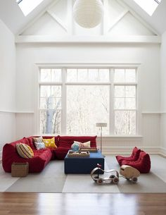 Red Togo Sofa Among Modern Design Decorated under Bright Living Room Interior