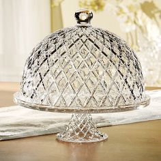 Domed crystal cake plate with beveled diamond detail. Product: Cake pedestal and domed lid Construction Material: Crystal Color: Clear Features: Embossed motif Perfect for bringing nostalgic appeal to your kitchen or dining roomDimensions: H x 11 Diameter