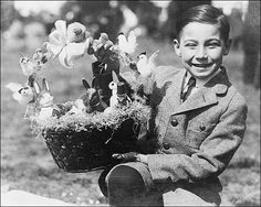 Easter photo taken at the White House Easter egg roll of a young boy, Warren Sonnemann, holding up a prize Easter basket.    PHOTOGRAPHER / CREDIT: National Photo Company Collection  DATE: April 2, 1923