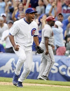 Carlos Marmol celebrates getting the save as the Cubs beat the Diamondbacks 4-1. 7/14/12