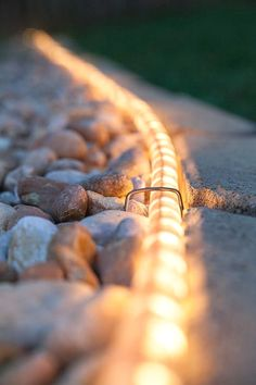 Outdoor spaces lacking in luster? You won't believe the transformation rope lights can make to your backyard, deck and walkways! #LandscapingIdeas