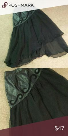 Beautiful, unique black leather skirt Beautiful, unique black leather skirt with double layer sheer fabric flowing to calf length. Size 8 Skirts Asymmetrical