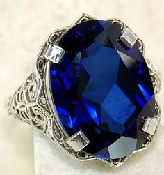 9 carat blue sapphire ring with solid .925 sterling silver Edwardian style filigree.  This ring was made from a original Victorian mold. $199.00