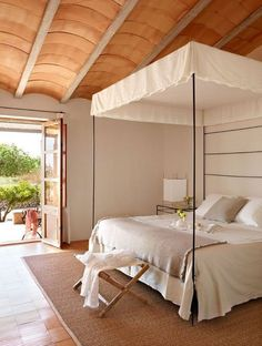"""hotel son bernadinet, spain the ceiling and folding doors give this a very """"warm"""" feeling against the stark crisp bed, nice touch with woven rug, the doors would be easy to re-create if you are a REALLY good DYI or have them installed, the ceiling could be adapted if you loved the wood"""