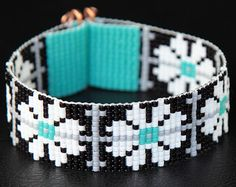 Black, White, Turquoise Floral Bead Loom Cuff Bracelet - Native American Style Beaded Jewelry - Flowers - Beadweaving - from PuebloAndCo on Etsy. Bead Loom Designs, Bead Loom Patterns, Bracelet Patterns, Beading Patterns, Bracelet Avec Photo, Seed Bead Jewelry, Beaded Jewelry, Bead Loom Bracelets, Cuff Bracelets