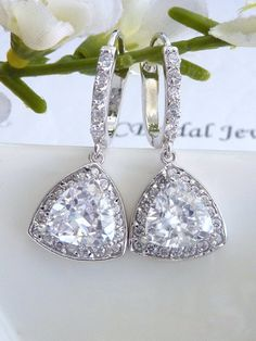 ORIGINAL DESIGN BY JCBRIDAL JEWELRY.    This earring features a high quality AAA unique trillion cut clear white triangle cubic zirconia (14 x 14