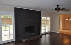 reclaimed wood mantel on brick fireplace - Google Search