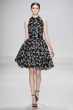 High neck, flouncy skirt.