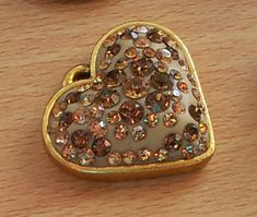 Crystal clay heart pendant.  We have lots of fabulous crystal clay colours available to compliment your crystal colour choice.  We also stock some fun and funky bezels.  www.crystalparade.co.uk