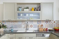 Kitchen with colorful wall tiles.