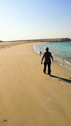 Jan & Chimaera.  Walking Chimaera on a December morning at Budaiya beach.