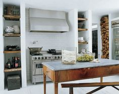 cool open monochromatic kitchen. I like the rustic wood shelves.