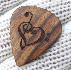 My tattoo on a guitar pick. Love this.
