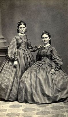 Set of twins in matching dresses, ca. 1862.