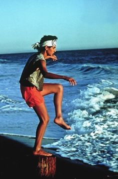 "Pin for Later: The Most Memorable Movie Beach Scenes The Karate Kid Between ""wax on, wax off"" moves, Daniel (Ralph Macchio) channels his best Mr. Miyagi-inspired Zen pose at the water's edge. scenes The Karate Kid Daniel Karate Kid, The Karate Kid 1984, Karate Kid Movie, Karate Kid Cobra Kai, Ralph Macchio, Miyagi, Famous Movies, Kid Movies, Iconic Movies"
