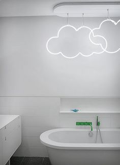 Custom neon clouds in a bathroom designed by Ghislaine Viñas - Photography by Eric Laignel