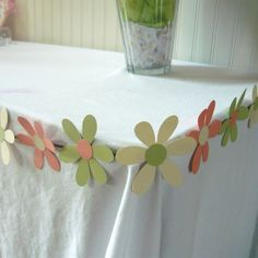Paper Flower Garland or streamers use for table decor or as hanging decorations (12 ft long). $14.00, via Etsy.