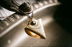 All Seeing Eye, golden brass triangle necklace with vintage black mother of pearl cabochon