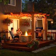 back deck, love the pergola and the twinkly lights
