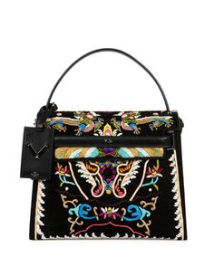 """Valentino """"My Rockstud"""" suede and vitello leather handbag with ornate dragon embroidery. Flat top handle; hanging logo tag with Rockstud accents. Removable shoulder strap; 28"""" drop. Flap top with keeper strap; magnetic closure. 9.5""""H x 11.5""""W x 4.5""""D. Made in Italy.  Italian designer Valentino Garavani held his first significant show in 1962 at Florence's Pitti Palace, an appropriate setting for his opulent collection."""